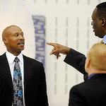 Cleveland Cavaliers head coach Byron Scott, left, speaks with members of the radio team Jim Chones, right, and John Michael during their NBA basketball media day at the team's training facil …