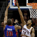 Cleveland Cavaliers' Tristan Thompson (13) defends against a shot by Detroit Pistons' Greg Monroe (10) in the fourth quarter of an NBA basketball game on Wednesday, April 10, 2013, in Clevel …