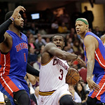 Cleveland Cavaliers' Dion Waiters (3) drives between Detroit Pistons' Andre Drummond (1) and Charlie Villanueva in the second quarer of an NBA basketball game on Wednesday, April 10, 2013, i …