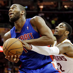 Cleveland Cavaliers' Kyrie Irving (2) tries to strip the ball from Detroit Pistons' Greg Monroe in the first quarter of an NBA basketball game on Wednesday, April 10, 2013, in Cleveland. (AP …