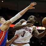 Cleveland Cavaliers' Dion Waiters (3) shoots over Detroit Pistons' Jonas Jerebko, from Sweden, in the fourth quarter of an NBA basketball game on Wednesday, April 10, 2013, in Cleveland. The …
