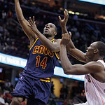 Cleveland Cavaliers' Lester Hudson (14) shoots against Charlotte Bobcats' Bismack Biyombo during the fourth quarter of an NBA basketball game Tuesday, April 10, 2012, in Cleveland. Hudson sc …