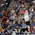 Philadelphia 76ers' Justin Holiday, right, shoots over Cleveland Cavaliers' Dion Waiters (3) during an NBA basketball game, Sunday, April 14, 2013, in Philadelphia. The 76ers won 91-77. (AP  …