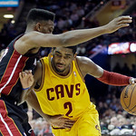 Cleveland Cavaliers' Kyrie Irving (2) tries to drive past Miami Heat's Norris Cole in the third quarter of an NBA basketball game Monday, April 15, 2013, in Cleveland. The Heat won 96-95. (A …