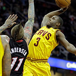 Cleveland Cavaliers' Dion Waiters (3) goes in for a dunk over Miami Heat's Chris Andersen (11) in the second quarter of an NBA basketball game Monday, April 15, 2013, in Cleveland. (AP Photo …