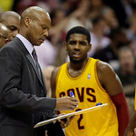 Cleveland Cavaliers head coach Byron Scott diagrams a play as Kyrie Irving (2) watches in the last seconds of the fourth quarter in an NBA basketball game against the Miami Heat Monday, Apri …