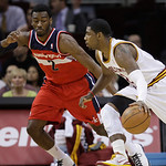 Cleveland Cavaliers' Kyrie Irving, right, drives past Washington Wizards' John Wall in the first quarter in an NBA basketball game on Wednesday, April 25, 2012, in Cleveland. (AP Photo/Tony …