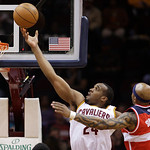 Cleveland Cavaliers' Samardo Samuels (24) shoots to the basket under pressure from Washington Wizards' James Singleton (3) in the first quarter in an NBA basketball game on Wednesday, April  …