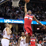 Washington Wizards' James Singleton (3) jumps to the basket against Cleveland Cavaliers' Anthony Parker (18) in the third quarter in an NBA basketball game on Wednesday, April 25, 2012, in C …