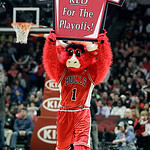 Chicago Bulls mascot Benny the Bull holds a sign during the first half of an NBA basketball game against the Cleveland Cavaliers in Chicago, Thursday, April 26, 2012. (AP Photo/Nam Y. Huh)