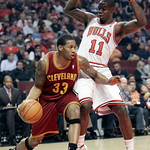 Cleveland Cavaliers forward Alonzo Gee (33) drives to the basket against Chicago Bulls guard Ronnie Brewer (11) during the first half of an NBA basketball game in Chicago, Thursday, April 26 …