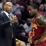Cleveland Cavaliers head coach Byron Scott, left, talks to guard Donald Sloan (15) during the first half of an NBA basketball game against the Chicago Bulls in Chicago, Thursday, April 26, 2 …