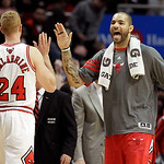 Chicago Bulls forward Carlos Boozer, right, celebrates with teammate Brian Scalabrine (24) during the second half of an NBA basketball game against the Cleveland Cavaliers in Chicago, Thursd …