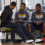 With their season ended, Cleveland Cavaliers players, from left, Tristan Thompson, Kyrie Irving, and Donald Sloan talk together at the team's practice facility in Independence, Ohio, on Frid …