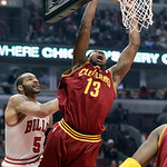 Cleveland Cavaliers forward Tristan Thompson (13) goes up for a shot against Chicago Bulls forward Carlos Boozer (5) during the first half of an NBA basketball game in Chicago, Thursday, Apr …
