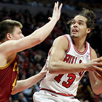 Chicago Bulls center Joakim Noah (13) looks to the basket as Cleveland Cavaliers forward Luke Harangody (44) guards during the second half of an NBA basketball game in Chicago, Thursday, Apr …
