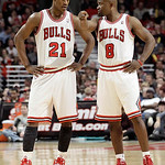 Chicago Bulls guard Mike James (8) points as he talks with Jimmy Butler (21) during the second half of an NBA basketball game against the Cleveland Cavaliers in Chicago, Thursday, April 26,  …