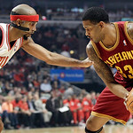 Chicago Bulls guard Richard Hamilton (32) guards Cleveland Cavaliers forward Alonzo Gee (33) during the first half of an NBA basketball game in Chicago, Thursday, April 26, 2012. (AP Photo/N …