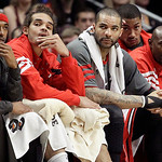 From left to right, Chicago Bulls' Richard Hamilton, Joakim Noah, Carlos Boozer, Derrick Rose and Mike James watch their team during the first half of an NBA basketball game against the Clev …
