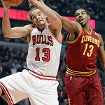 Chicago Bulls center Joakim Noah (13) battles for a rebound against Cleveland Cavaliers forward Tristan Thompson (13) during the first half of an NBA basketball game in Chicago, Thursday, Ap …