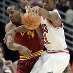 Chicago Bulls guard Jimmy Butler, right, controls the ball against Cleveland Cavaliers center Samardo Samuels (24) during the second half of an NBA basketball game in Chicago, Thursday, Apri …