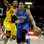 Orlando Magic's Tobias Harris, front, drives past Cleveland Cavaliers' Alonzo Gee during the first quarter of an NBA basketball game Sunday, April 7, 2013, in Cleveland. The Cavaliers won 91 …