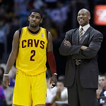 Cleveland Cavaliers head coach Byron Scott, right, talks with guard Kyrie Irving during the fourth quarter of an NBA basketball game Sunday, April 7, 2013, in Cleveland. The Cavaliers won 91 …