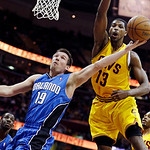 Orlando Magic's Beno Udrih (19), of Slovenia, shoots under pressure from Cleveland Cavaliers' Tristan Thompson (13) during the first quarter of an NBA basketball game, Sunday, April 7, 2013, …