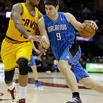 Orlando Magic's Nikola Vucevic (9), from Montenegro, drives past Cleveland Cavalier's Marreese Speights (15) during the fourth quarter of an NBA basketball game Sunday, April 7, 2013, in Cle …