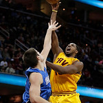 Cleveland Cavaliers' Tristan Thompson (13) shoots over Orlando Magic's Nikola Vucevic (9), from Montenegro, during the second quarter of an NBA basketball game Sunday, April 7, 2013, in Clev …