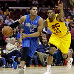 Orlando Magic's Tobias Harris (12) drives past Cleveland Cavaliers' Alonzo Gee (33) during the first quarter of an NBA basketball game Sunday, April 7, 2013, in Cleveland. The Cavaliers won  …