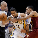 Referee Ron Garretson, left, watches as Indiana Pacers guard D.J. Augustin, center is fouled by Cleveland Cavaliers guard Shaun Livingston in the second half of an NBA basketball game in Ind …