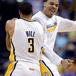 Indiana Pacers guard George Hill, left, and forward Gerald Green celebrate as the Pacers took the lead against the Cleveland Cavaliers late in the second half of an NBA basketball game in In …