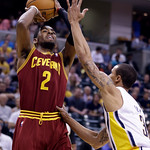 Cleveland Cavaliers guard Kyrie Irving, left, shoots over Indiana Pacers guard George Hill in the first half of an NBA basketball game in Indianapolis, Tuesday, April 9, 2013. (AP Photo/Mich …