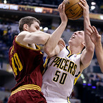 Cleveland Cavaliers center Tyler Zeller, left, fouls Indiana Pacers forward Tyler Hansbrough in the second half of an NBA basketball game in Indianapolis, Tuesday, April 9, 2013. The Pacers  …
