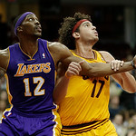 Los Angeles Lakers' Dwight Howard (12) and Cleveland Cavaliers' Anderson Varejao (17), from Brazil, battle for position in an NBA basketball game Tuesday, Dec. 11, 2012, in Cleveland. (AP P …
