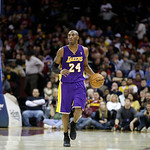 Los Angeles Lakers' Kobe Bryant brings the ball up against the Cleveland Cavaliers in an NBA basketball game Tuesday, Dec. 11, 2012, in Cleveland. (AP Photo/Mark Duncan)