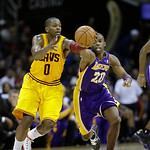 Cleveland Cavaliers' C.J. Miles (0) and Los Angeles Lakers' Jodie Meeks (20) fight for a loose ball in an NBA basketball game Tuesday, Dec. 11, 2012, in Cleveland. (AP Photo/Mark Duncan)