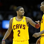 Cleveland Cavaliers' Kyrie Irving (2) talks with C.J. Miles during an NBA basketball game against the Los Angeles LakersTuesday, Dec. 11, 2012, in Cleveland. (AP Photo/Mark Duncan)