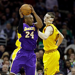 Los Angeles Lakers' Kobe Bryant (24) rebounds against Cleveland Cavaliers' Tyler Zeller in an NBA basketball game Tuesday, Dec. 11, 2012, in Cleveland. (AP Photo/Mark Duncan)