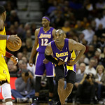 Los Angeles Lakers' Kobe Bryant defends against Cleveland Cavaliers' Kyrie Irving, left, in an NBA basketball game Tuesday, Dec. 11, 2012, in Cleveland. (AP Photo/Mark Duncan)