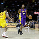 Los Angeles Lakers' Kobe Bryant (24) works against Cleveland Cavaliers' Alonzo Gee in an NBA basketball game Tuesday, Dec. 11, 2012, in Cleveland. (AP Photo/Mark Duncan)