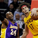 Cleveland Cavaliers' Anderson Varejao (17), of Brazil, tries to control a rebound against Los Angeles Lakers' Kobe Bryant (24) in the first quarter of an NBA basketball game, Tuesday, Dec. 1 …