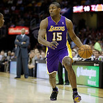 Los Angeles Lakers' Metta World Peace (15) drives against the Cleveland Cavaliers in an NBA basketball game Tuesday, Dec. 11, 2012, in Cleveland. (AP Photo/Mark Duncan)