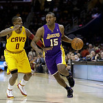 Los Angeles Lakers' Metta World Peace (15) drives past Cleveland Cavaliers' C.J. Miles in an NBA basketball game Tuesday, Dec. 11, 2012, in Cleveland. (AP Photo/Mark Duncan)