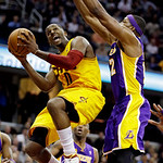 Cleveland Cavaliers' C.J. Miles, left, goes in for a shot against Los Angeles Lakers' Dwight Howard in the second quarter of an NBA basketball game, Tuesday, Dec. 11, 2012, in Cleveland. (AP …