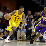 Cleveland Cavaliers' Alonzo Gee (33) drives on Los Angeles Lakers' Kobe Bryant (24) in an NBA basketball game Tuesday, Dec. 11, 2012, in Cleveland. (AP Photo/Mark Duncan)