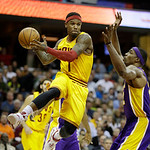 Cleveland Cavaliers' Daniel Gibson (1) passes around Los Angeles Lakers' Dwight Howard in an NBA basketball game Tuesday, Dec. 11, 2012, in Cleveland. (AP Photo/Mark Duncan)