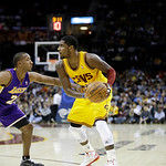 Los Angeles Lakers' Jodie Meeks, left, defends Cleveland Cavaliers' Kyrie Irving in an NBA basketball game Tuesday, Dec. 11, 2012, in Cleveland. (AP Photo/Mark Duncan)