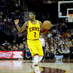 Cleveland Cavaliers' Kyrie Irving calls a play against the Los Angeles Lakers in an NBA basketball game Tuesday, Dec. 11, 2012, in Cleveland. (AP Photo/Mark Duncan)